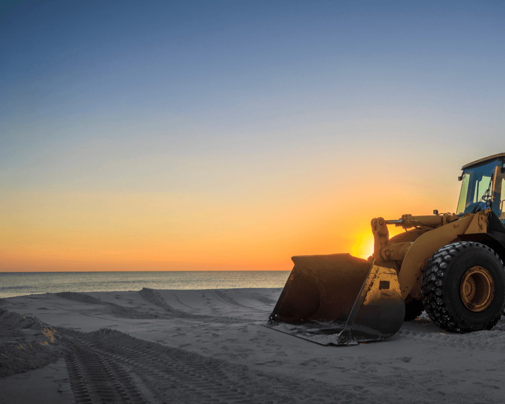 A bulldozer is shown at sunset for under construction
